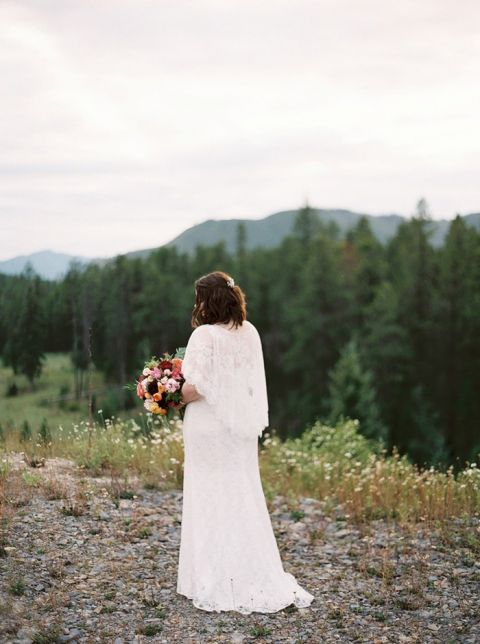 Mountain Bride in a Lace Capelet Wedding Dress