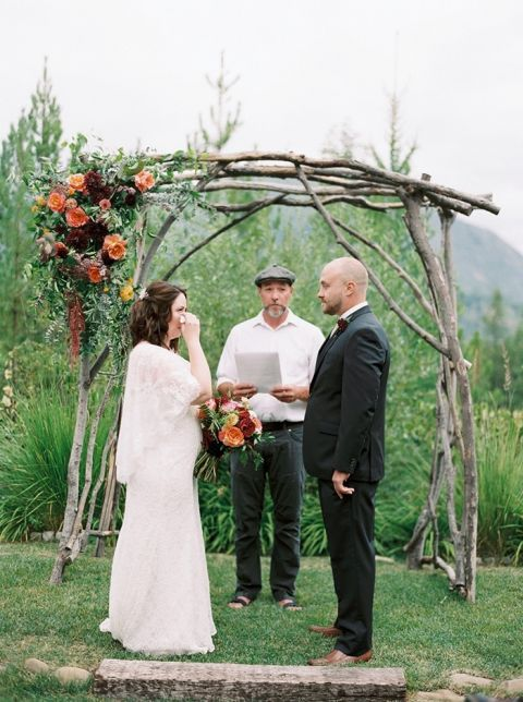 Heartfelt Ceremony with a Rustic Wood and Floral Arch