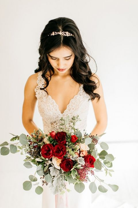 Romantic Lace Wedding Dress with a Red and Greenery Bouquet