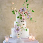 Wedding Cake with Hand Painted Sugar Flowers in Peach and Purple