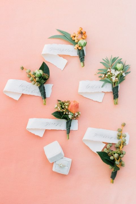 Boutonnieres with Hand Lettered Tags and a Vintage Engagement Ring on an Ombre Coral Background