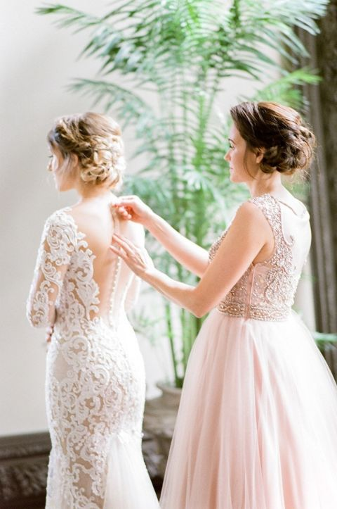 Helping the Bride into her Nude Illusion Lace Wedding Dress