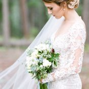 Bride with a Long Sleeve Lace Dress and Organic Bouquet