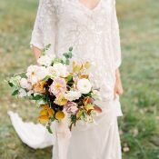 Elegant Sparkling Bohemian Wedding Dress with a Fall Bouquet