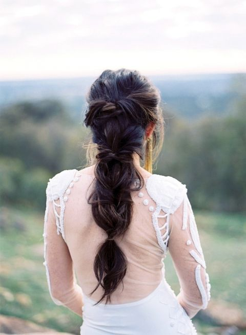 Dramatic Braided Bridal Hairstyle with an Open Back Wedding Dress