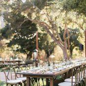 Wedding Reception with Farm Tables under Bistro Lights
