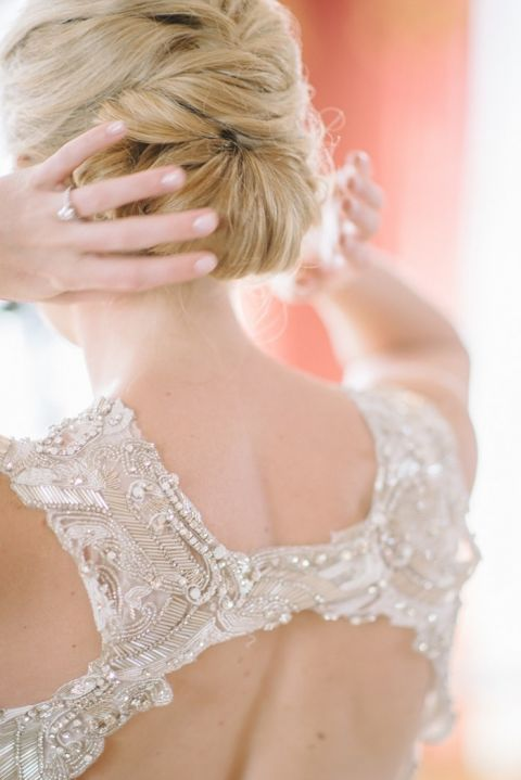 Elegant Bridal Hairstyle with a Jeweled Wedding Dress
