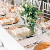 Gold and White Wedding Head Table with Spring Greenery