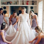 Bridesmaids in Lilac Dresses Helping the Bride Get Ready