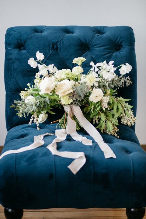 Greenery and White Organic Floral Bouquet on an Indigo Velvet Chair