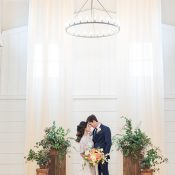 Elegant Barn Wedding Ceremony with Draping and Greenery