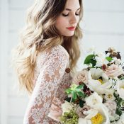 Bride with a Long Sleeve Lace Wedding Dress and Summer Peony Bouquet