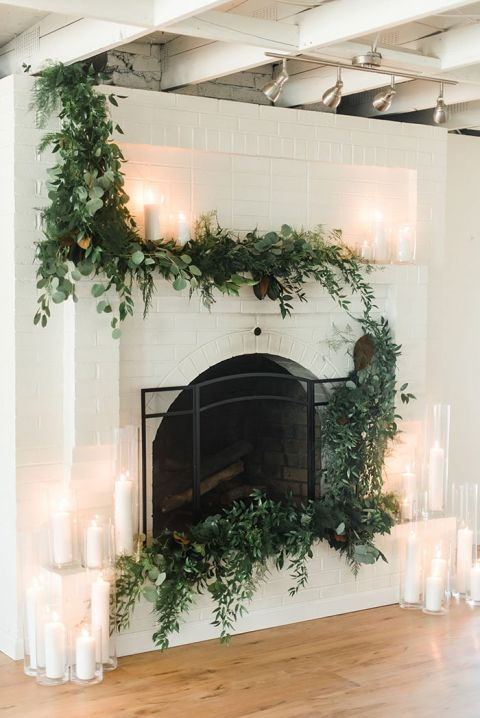 Fireplace Ceremony Backdrop with Greenery and Candles