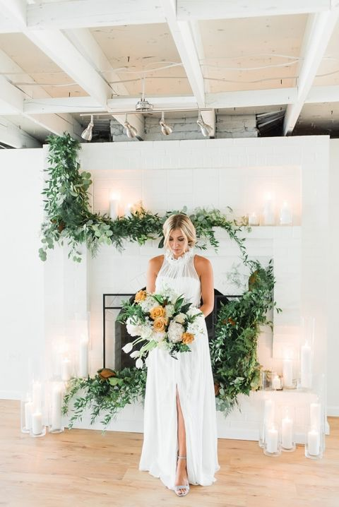 Minimalist Ceremony Decor with Greenery Garlands and Candles
