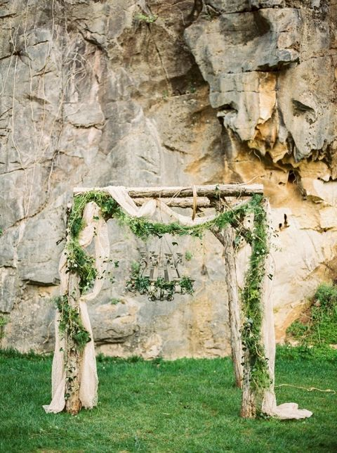 Enchanted Forest Ceremony Arch with a Moss Chandelier