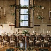 Modern Rustic Wedding Reception with Hanging Greenery and Geometric Decor
