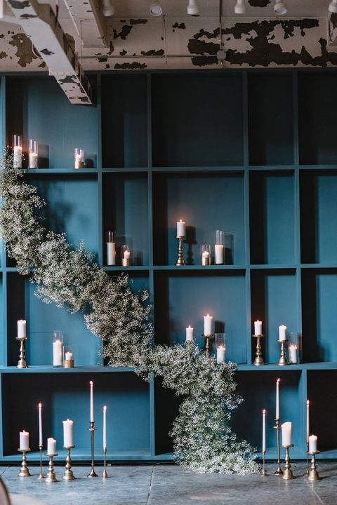 Modern Ceremony Backdrop with a Floral Garland and Candles