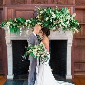 Modern Greenery Ceremony Decor on a Vintage Mantelpiece