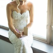 Bride in a Fitted Lace Wedding Dress Writing Her Vows
