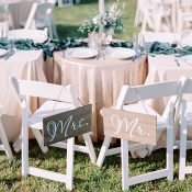 Rustic Wedding Sweetheart Table with Gold Sequin Tablecloths and Barn Wood