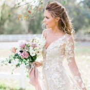 Romantic Half Up Bridal Hairstyle with a Long Sleeve Lace Wedding Dress