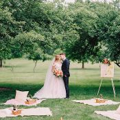 Picnic Inspired Summer Wedding Ceremony with Lush Greenery