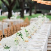 White and Gold Minimalist Wedding Tables under Bistro Lights
