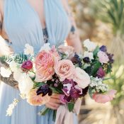 Dusty Purple and Mauve Bouquet with a Blue Bridesmaid Dress