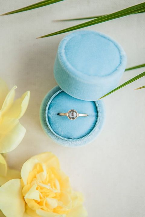 Unique Gold and Gemstone Engagement Ring in a Blue Velvet Box