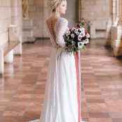 Dramatic Lace Wedding Dress with an Open Back and Garnet Bouquet
