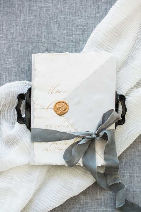 Silk Ribbon Tied around Wedding Invitations