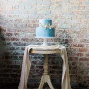 Exposed Brick Backdrop for a Vintage Blue and Gold Wedding Cake