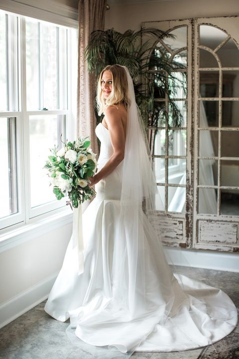 Architectural Satin Wedding Dress with an Organic Greenery Bouquet