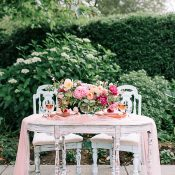 Antique White Sweetheart Table with a Peach Runner