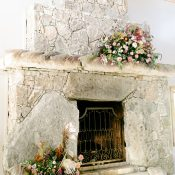 Neutral Stone Fireplace Wedding Ceremony Backdrop