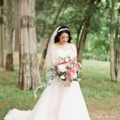 Romantic Blush A-Line Wedding Dress with a Pink Bouquet