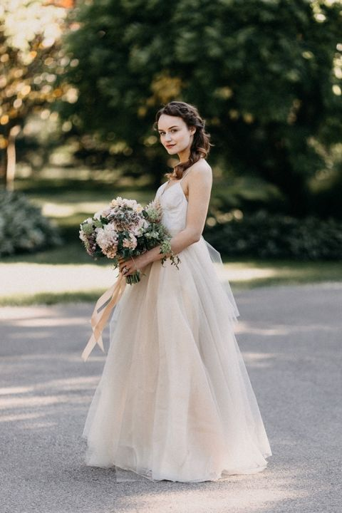 Blush Pink Tulle Wedding Dress with a Blush Bouquet