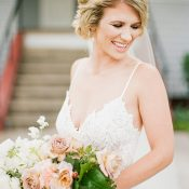 Glowing Southern Bride with a Lace Wedding Dress and Peach Bouquet