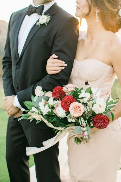 Stylish Black Tie Wedding with a Nude Wedding Dress and a Red Bouquet