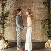Brick Wall Wedding Ceremony Backdrop with Organic Fall Flowers