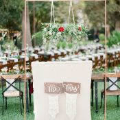 Sweetheart Table with a Vintage Settee and Macrame Table Signs under a Greenery Chandelier