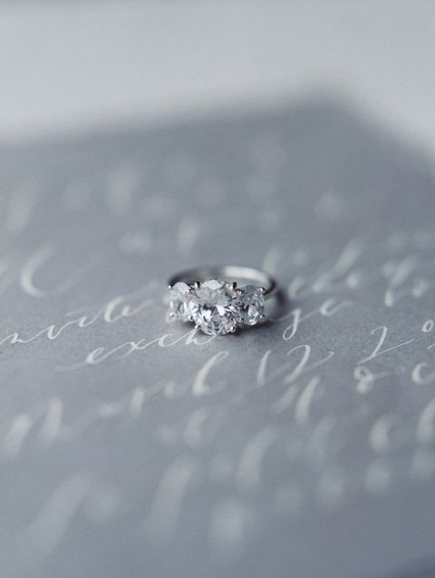 Three Stone Engagement Ring with a White Gold Band