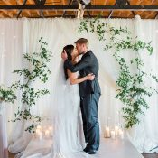 Intimate Wedding Ceremony with White Drapery and a Greenery Backdrop