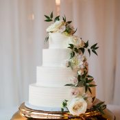 Elegant White Wedding Cake with Summer Flowers and Greenery