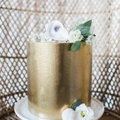Minimalist Metallic Wedding Cake with Gold Leaf and White Flowers