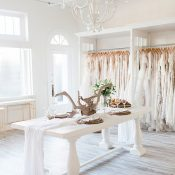 White Farm Table with a Wooden Chandelier