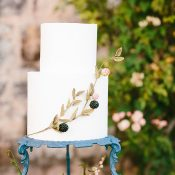 Simple Elegance Wedding Cake with a Gold and Blackberry Motif
