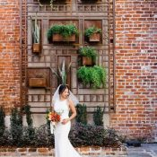 Living Greenery Brick Wall Backdrop for a Modern Chic Bride