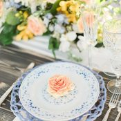 Pastel Blue Patterned Place Setting with Peach and Yellow Flowers