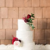Buttercream Wedding Cake with Red and Berry Flowers